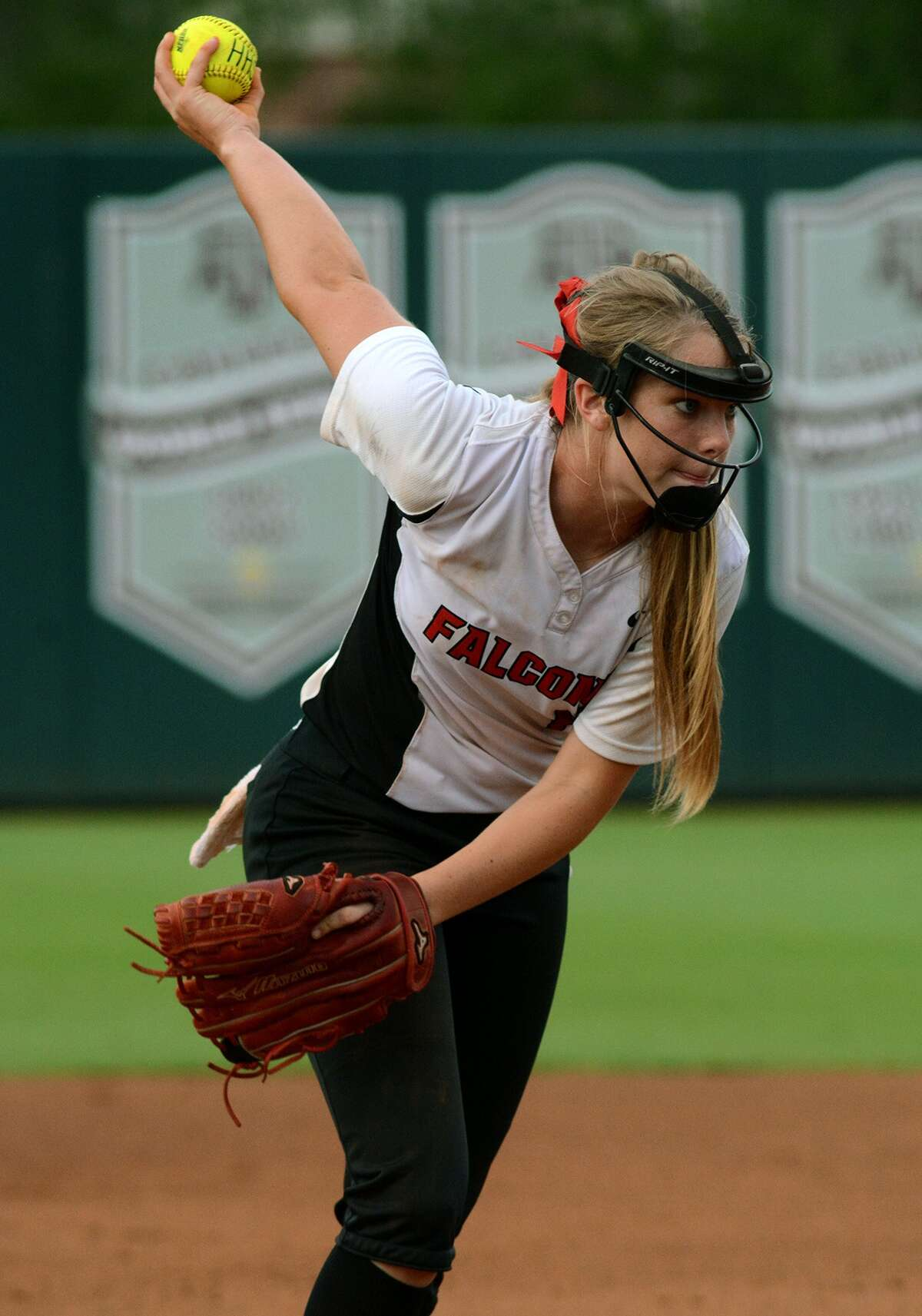Huffman pitcher Savanna Cates works against a La Grange hitter during game one of their Region III Class 4A finals matchup at Texas A&M University on Wednesday, May 27, 2015. (Photo by Jerry Baker/Freelance)