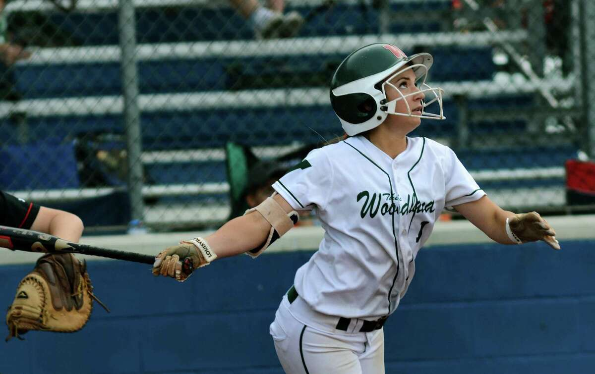 The Woodlands senior shortstop Aubrey Leach, above, was solid at the plate, while senior Shelby Dublin took care of matters at first against Lake Travis at Mumford High School last week.