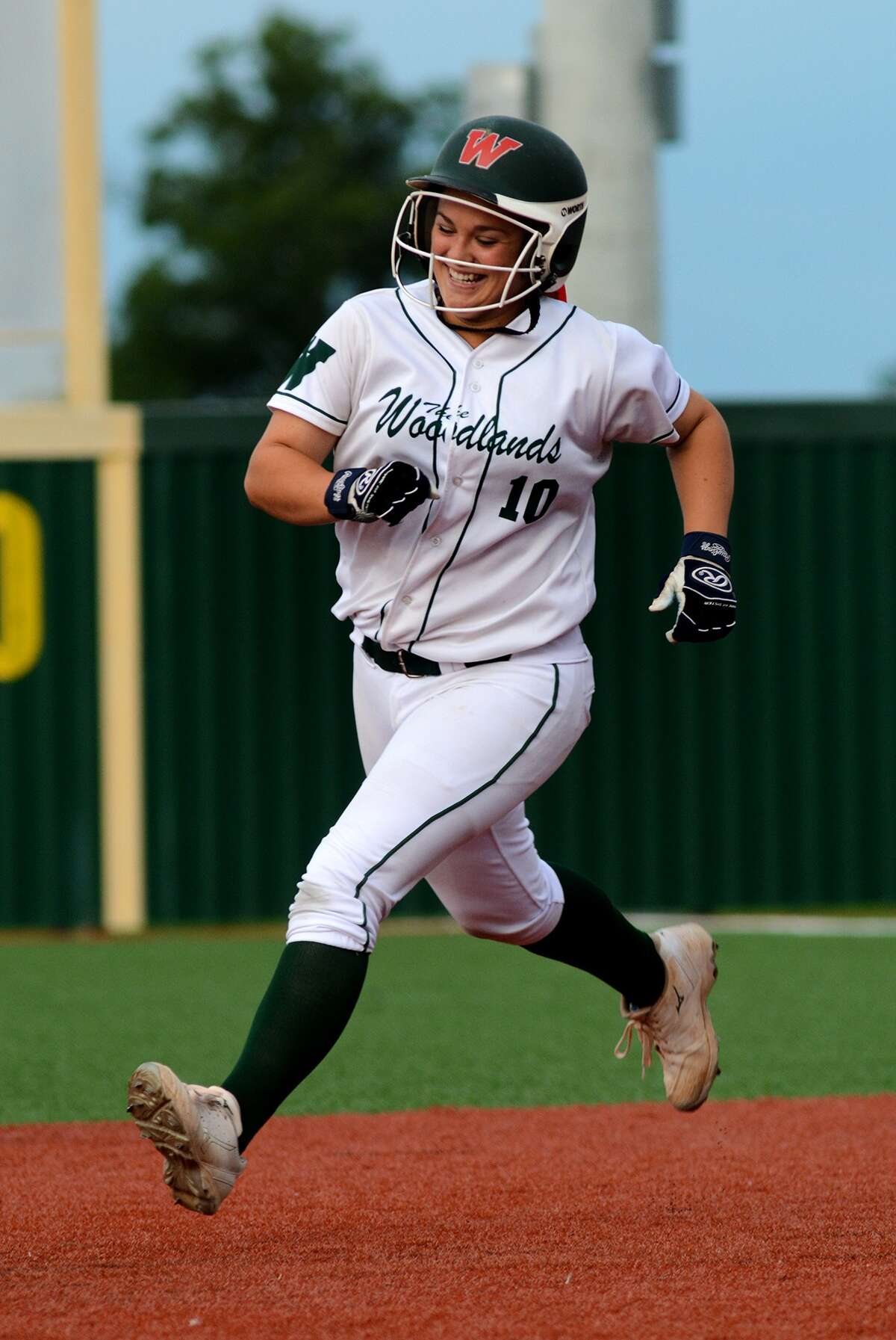 The Woodlands sophomore catcher Kelcy Leach is all smiles as she runs the bases after her 8th inning, game-winning homerun against Lake Travis in game 2 of their 2015 UIL Regional Finals matchup at Mumford High School on Saturday, May 30, 2015. (Photo by Jerry Baker/Freelance)