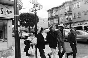 SAN FRANCISCO - 1967:  Hippies dawdle at the corner of Haight and Ashbury Streets, the epicenter of the Summer of Love, in San Francisco, California, on May 4, 1967.  (Photo by Michael Ochs Archives/Getty Images)
