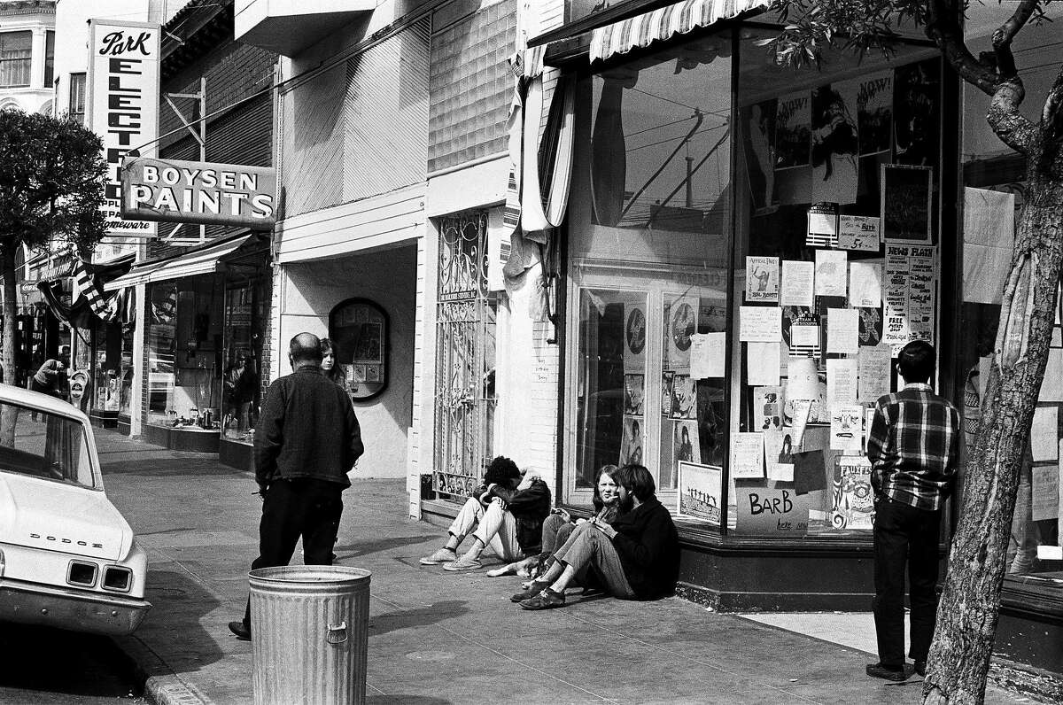 Hippies lounge in front of a local establishment in the Haight-Ashbury district in San Francisco in the early summer of 1967.