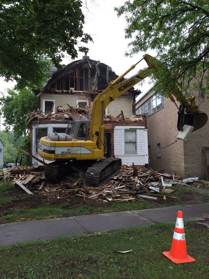 After 7 years of negotiations with the city, neighbors and historic preservationists, St. Andrew's Episcopal Church in Albany began demolishing its former rectory at 473 Western Ave. Tuesday to make way for a two-story expansion to its parish hall. (Jordan Carleo-Evangelist/Times Union)
