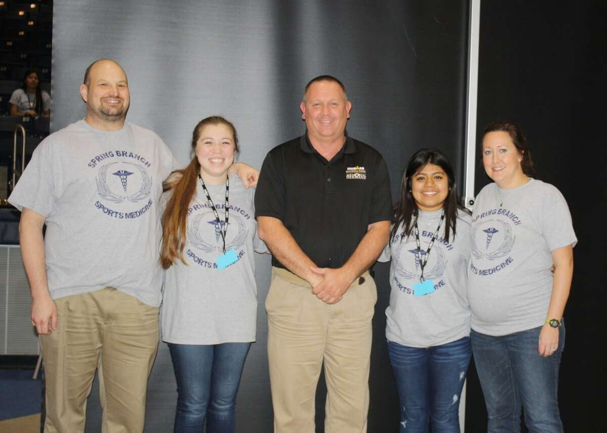 Six Spring Branch Independent School District athletic trainers were recently awarded Sports Medicine scholarships from Memorial Hermann Memorial City Medical Center, the official healthcare provider for the district. Stratford High Schoolés recipents are Alexis Romero and Sindi Romero. From left are: Sean Plake, SHS assistant athletic trainer; Alexis; David Wilkinson, Memorial Hermann Sports Medicine outreach athletic trainer; Sindi Romero; Cathlene Webb, SHS head athletic trainer