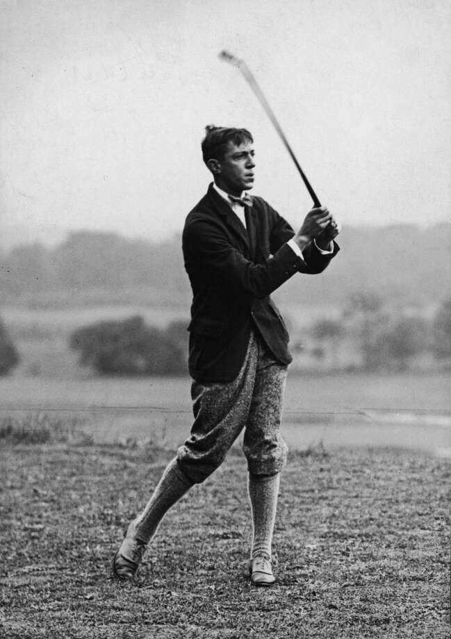 """1913 — From caddie to champion The Country Club, Boston, Massachusetts     Francis Ouimet, a 20-year-old who lived across the street from The Country Club where he used to be a caddie, won an 18-hole playoff against the two best players in the world at the time, Harry Vardon and Ted Ray, in the 1913 U.S. Open. Ouimet's upset was front-page news across America and influenced the movie, """"The Greatest Game Ever Played,"""" which came out in 2005.     Photo: FPG, Getty Images"""