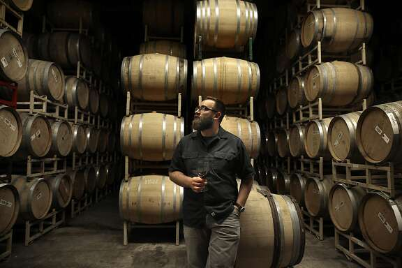 Michael Cruse tastes vin clair in the barrel room at Cruse Wine Co. in Petaluma, California, on Monday, June 1, 2015.
