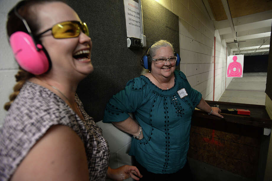 Christy Kamp (left) jokes with her aunt Debbie Schmitz as she gets experience in firing a handgun during the first meeting of the newly-formed Pretty Pistols and Pearls Women's Shooting Club at Lone Star Indoor Gun Range Thursday. The club will have scheduled meetings one Thursday a month, and members will be able to shoot at the range on Thursdays for a discounted fee. 
