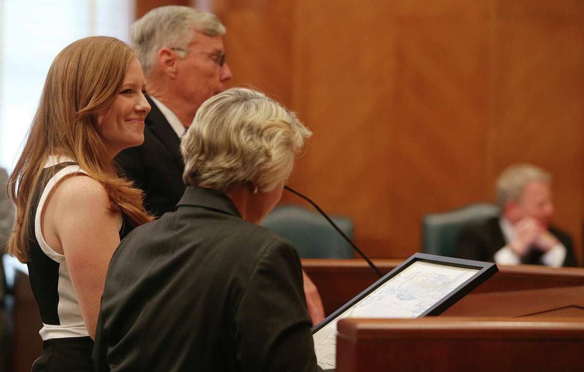 Council member Jack Christie and Mayor Annise Parker recognize Houston Chronicle Columnist Lisa Falkenberg in the City Council Chambers for winning the Pulitzer on Tuesday, June 2, 2015, in Houston. ( Mayra Beltran / Houston Chronicle )