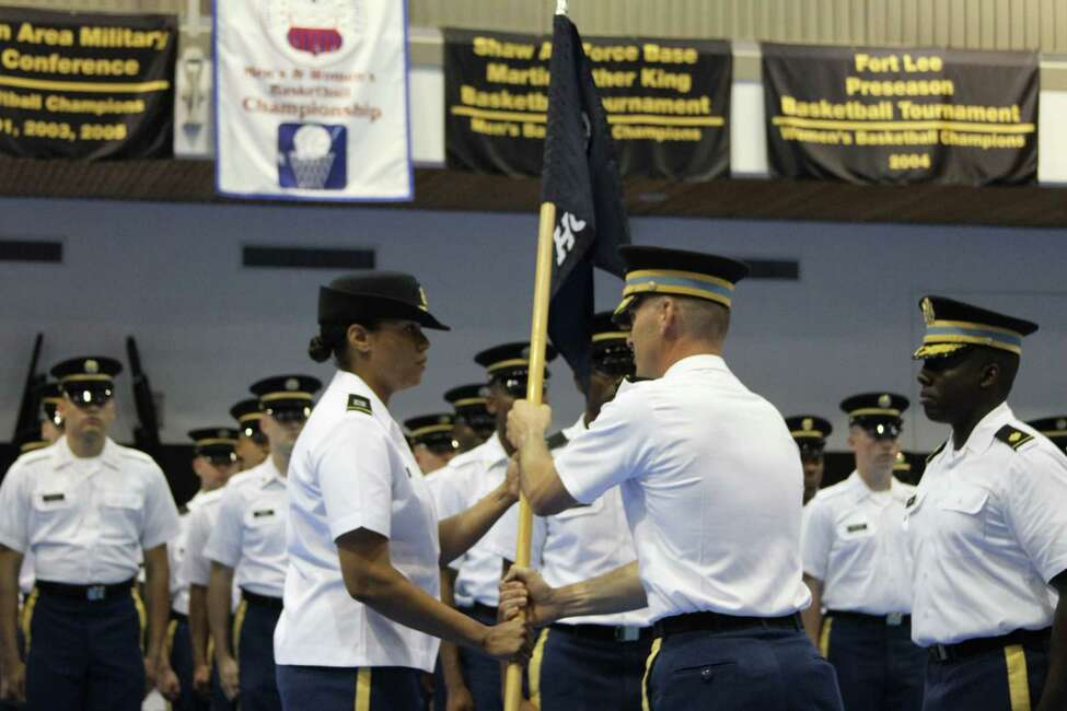Lieutenant Colonel Ryan Morgan passes the ceremonial flag to Captain Marjana Bidwell at a change of command ceremony, making her the first female commander of the Third U.S. Infantry Regiment Headquarters Company Tuesday, June 2, 2015, in Arlington, Va. (Tatiana Cirisano/Special to the Times Union)