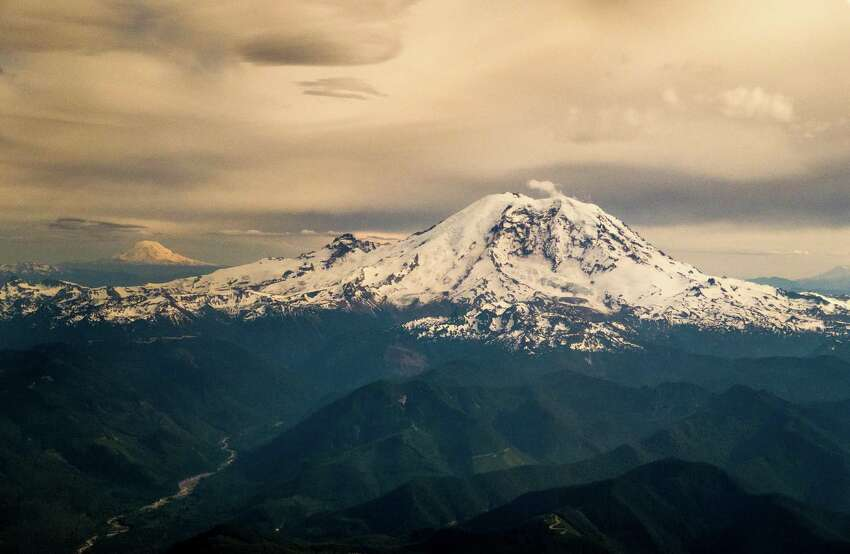 Mount Rainier is shown in evening light with Mount Adams in the background as seen from a flight in a commercial airliner on Sunday, June 1, 2015.