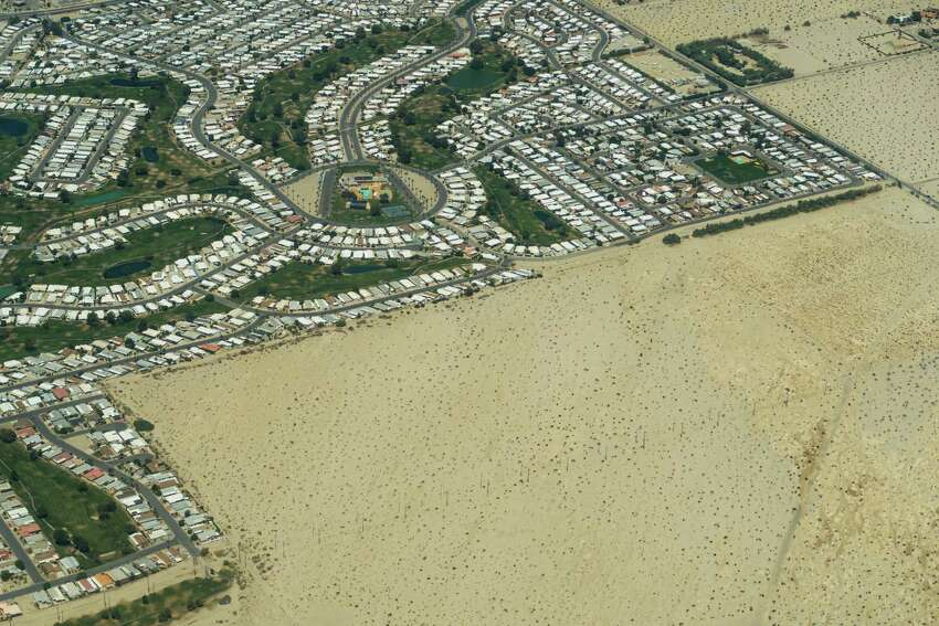 The city of Palm Springs, Calif.,and the surrounding desert is shown during a flight in a commercial airliner on Saturday, May 23, 2015.