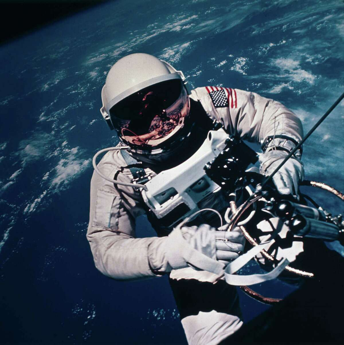 """Jan. 1, 1965 : Gemini 4 astronaut Ed White made the first spacewalk or EVA (extra vehicular activity) by an American. He spent more than 20 minutes outside his spacecraft. The """"umbilical cord"""" connecting him to the capsule supplied him with oxygen, and he held a rocket gun which he fired to help him move around in the vacuum of space. Gemini 4, crewed by James McDivitt and White, was launched on June 3, 1965 and completed 62 Earth orbits. It was the second manned launch of NASA's two-man Gemini spacecraft."""
