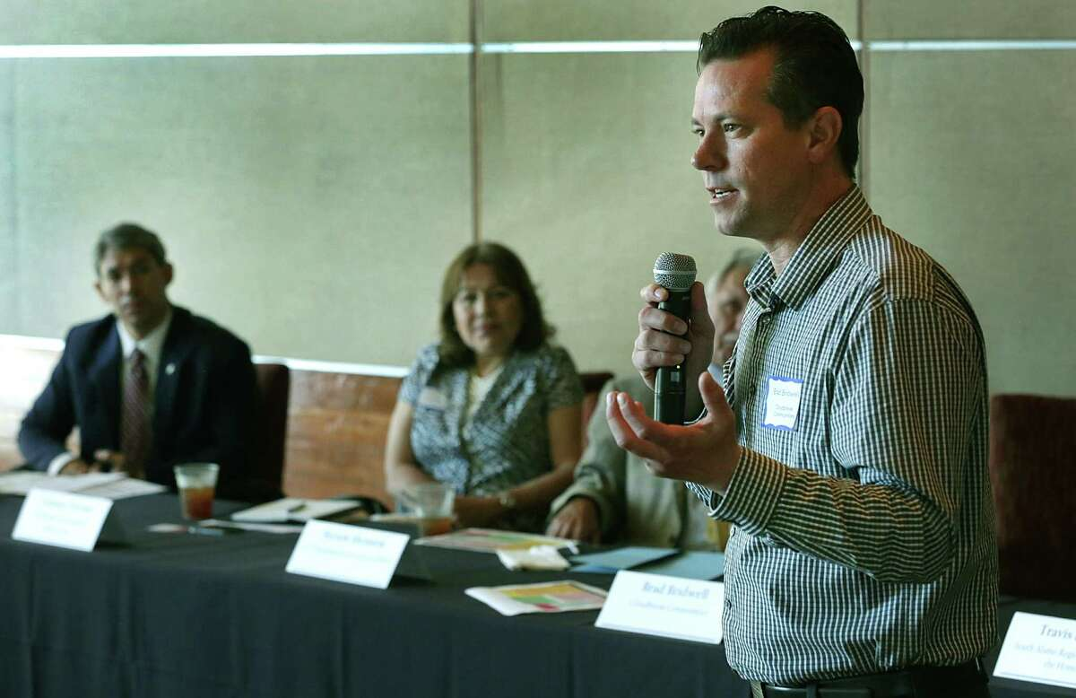 Brad Bridwell, of Clowudbreak Communities in Phoenix, AZ, speaks at a panel discussion lead by city councilman Ron Nirenberg, left, concerning homeless veterans and how to provide housing for them, on Tuesday June 2, 2015, held at The International Center.