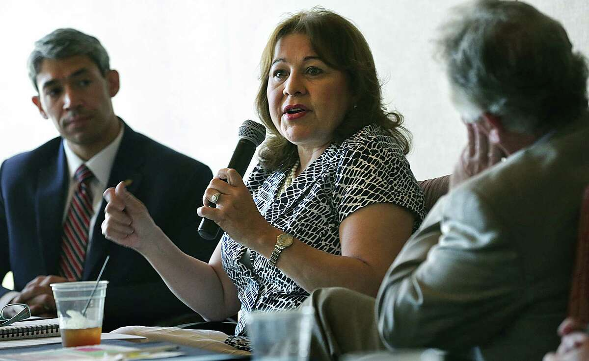 Tammye Trevino, center, HUD Office of the Regional Administrator, speaks at a panel discussion lead by city councilman Ron Nirenberg, left, concerning homeless veterans and how to provide housing for them, on Tuesday June 2, 2015, held at The International Center.