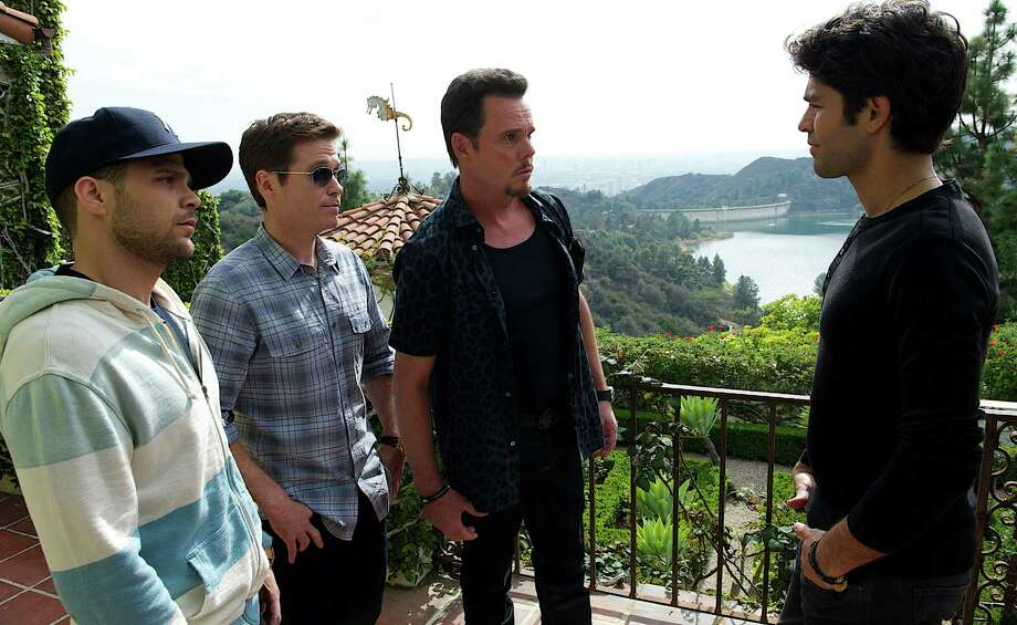 """HOLD FOR STORY - This photo provided by Warner Bros. Pictures shows, from left, Jerry Ferrara as Turtle, Kevin Connolly as Eric, Kevin Dillon as Johnny Drama and Adrian Grenier as Vince in Warner Bros. Pictures,' Home Box Office's and RatPac-Dune Entertainment's comedy """"Entourage,"""" a Warner Bros. Pictures release. (Claudette Barius/Warner Bros. Pictures via AP) ORG XMIT: CAET623 Photo: Claudette Barius / Warner Bros. Pictures"""