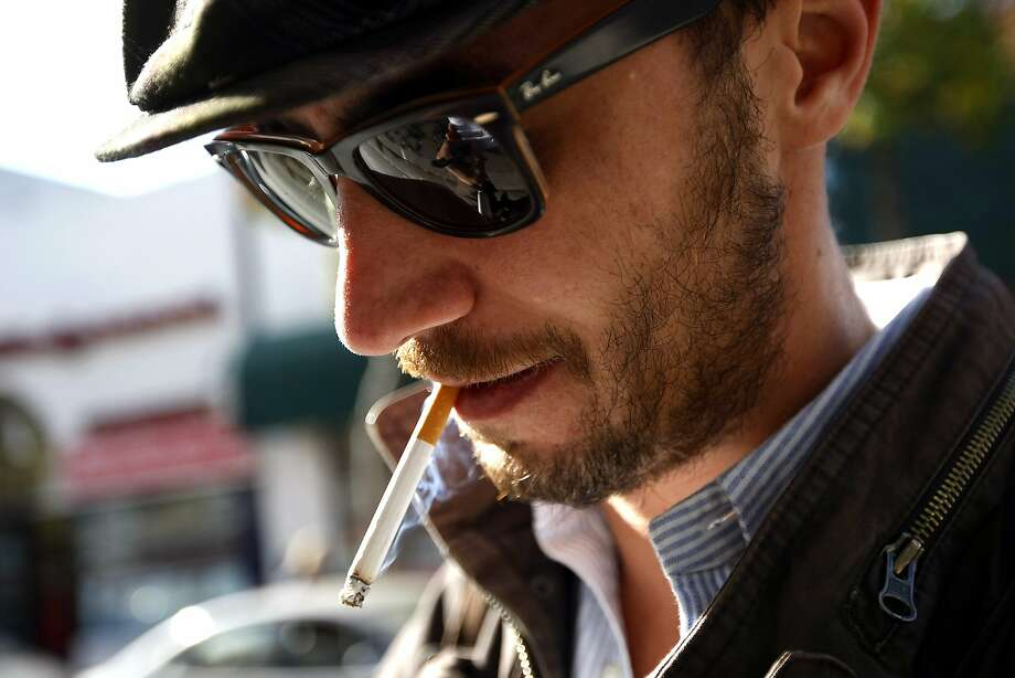 UC Berkeley student Petro Mencagli from Italy says he doesn't understand why America has been so aggressive in banning smoking, as he smokes on Telegraph Avenue in Berkeley in 2013. Photo: Michael Short, The Chronicle