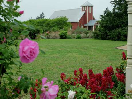 The Antique Rose Emporium features eight acres of themed display gardens on a pioneer homestead.