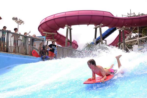 A child rides the Boogie Bahn during the opening weekend at Schlitterbahn Galveston Saturday, May 16, 2015, in Galveston. ( Jon Shapley / Houston Chronicle )