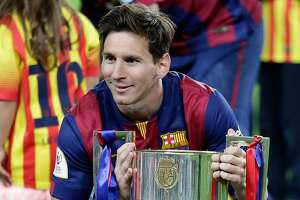 Barcelona's Lionel Messi poses with the trophy after winning the final of the Copa del Rey soccer match between FC Barcelona and Athletic Bilbao at the Camp Nou stadium in Barcelona, Spain, Saturday, May 30, 2015. (AP Photo/Manu Fernandez)