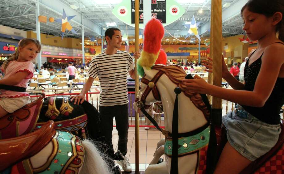 Children ride the carousel in the food court at Katy Mills Mall. Photo: Sharon Steinmann, Staff / Houston Chronicle