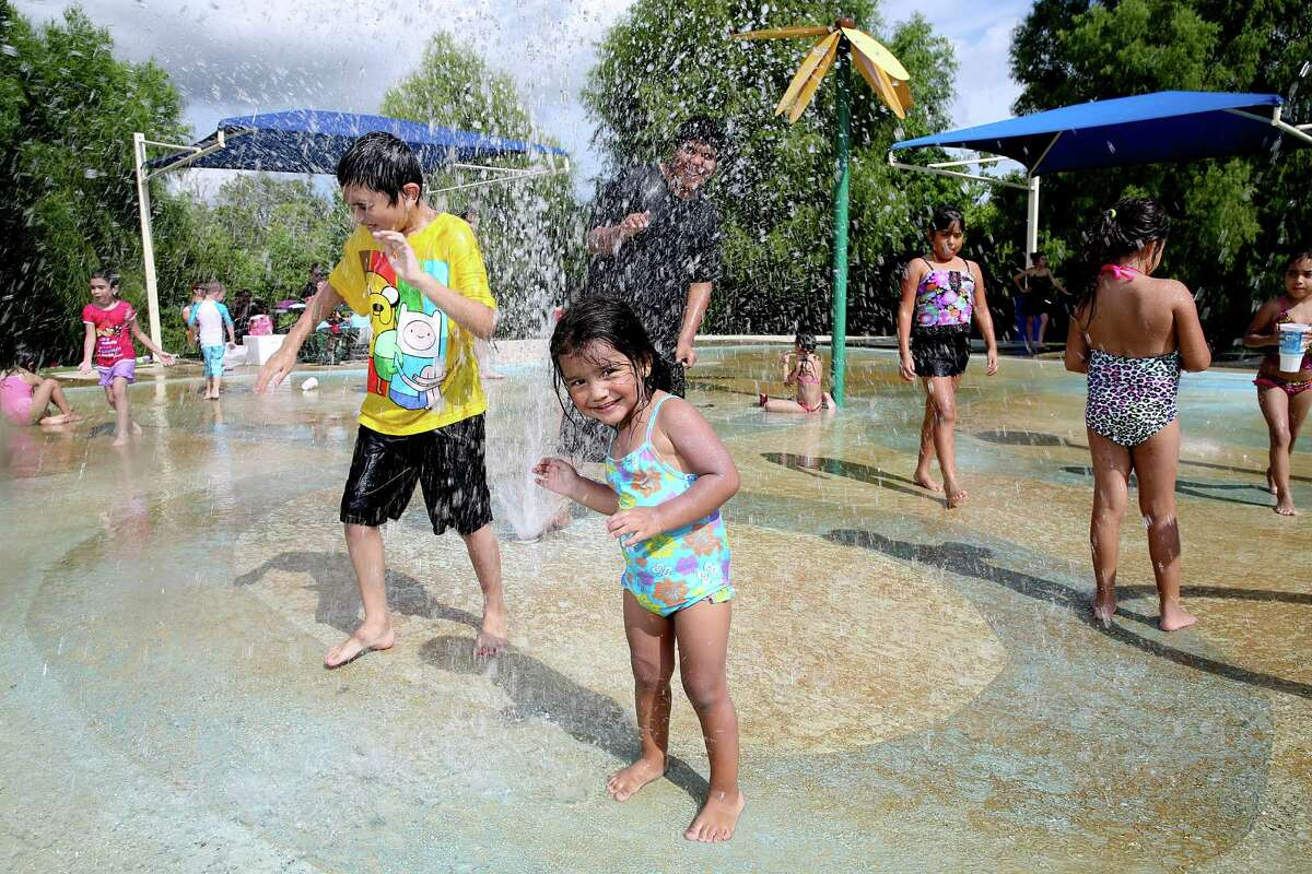 Kids plays at the Splash Pad at Centennial Park in Pearland.
