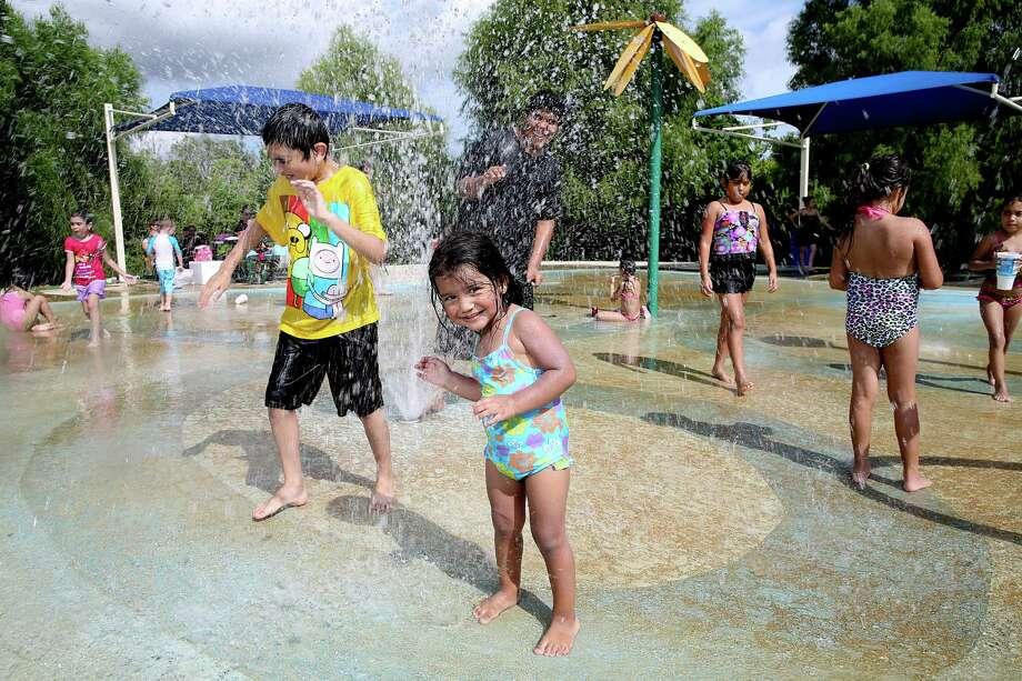 Kids plays at the Splash Pad at Centennial Park in Pearland. Photo: Thomas B. Shea / © 2014 Thomas B. Shea