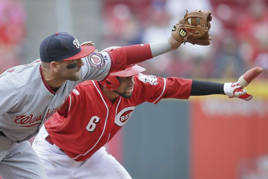 The Reds' Billy Hamilton is safe on this steal attempt against Washington. Through Monday, he led the majors with 21 steals. Photo: John Minchillo, Associated Press