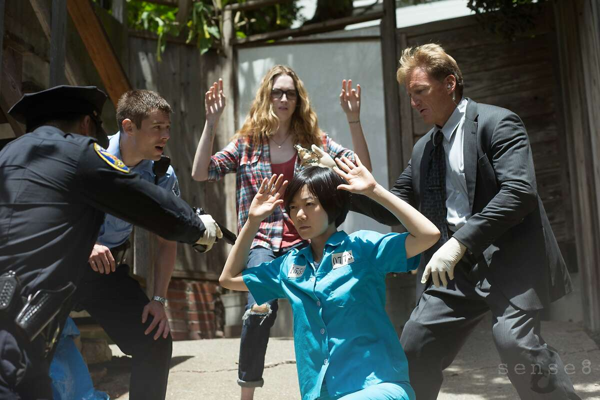 Brian J. Smith (L), Jamie Clayton (C), Doona Bae (C) and Paul Crawford (R) in a scene from Netflix's