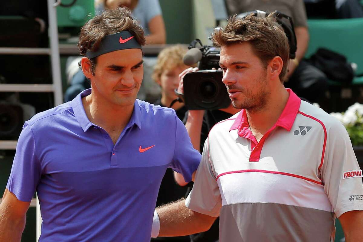 Switzerland's Roger Federer, left, and Switzerland's Stan Wawrinka pose for photographers prior to their quarterfinal match of the French Open tennis tournament against at the Roland Garros stadium, in Paris, France, Tuesday, June 2, 2015. (AP Photo/Francois Mori) ORG XMIT: PDJ149