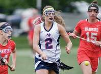 New Fairfield High School's Katie Clark tries for the loose ball in the Girls Lacrosse-M game against Branford High School, played at New Fairfield. Tuesday, June 2, 2015