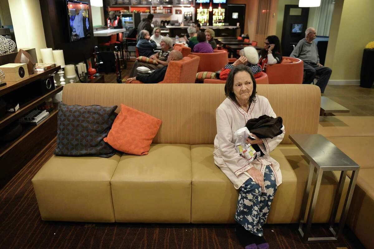 Charlene Lowry, who was a resident of the Wedgwood Senior Living high-rise, sits in a hotel lobby after being evacuated from the Castle Hills facility.