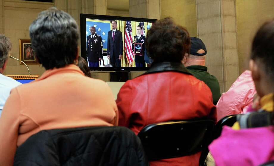 An enthusiastic audience watches a TV broadcast of President Barack Obama awarding the Medal of Honor to Army Sgt. Henry Johnson at City Hall Tuesday June 2, 2015 in Albany, NY.  (John Carl D'Annibale / Times Union) Photo: John Carl D'Annibale / 00032076A
