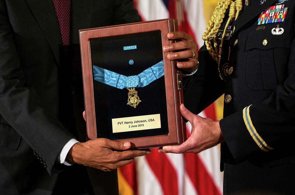 President Barack Obama, left, confers a posthumous Medal of Honor upon Pvt. Henry Johnson, a World War I veteran, during a ceremony at the White House in Washington, June 2, 2015. For decades, the Army had resisted efforts to award a Medal of Honor to Johnson, who like many other black soldiers technically served under French command in an era when American troops were segregated. (Doug Mills/The New York Times)