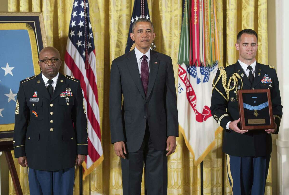US President Barack Obama presents the Medal of Honor to Command Sergeant Major Louis Wilson(L) of the New York National Guard, who is accepting on behalf of the late Army Private Henry Johnson, for actions while serving in France during World War I, during a ceremony in the East Room of the White House in Washington, DC, June 2, 2015. Obama also awarded a Medal of Honor to the late Army Sergeant William Shemin for his actions, also during World War I. AFP PHOTO / SAUL LOEBSAUL LOEB/AFP/Getty Images)
