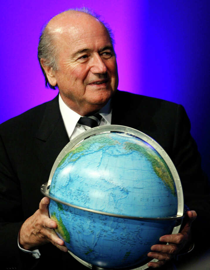 FILE - In this Thursday, May 31, 2007 file photo FIFA President Sepp Blatter receives a globe after being re-elected as President during the 57th FIFA congress in Zurich, Switzerland. FIFA President Sepp Blatter will resign from soccer's governing body amid a widening corruption scandal and promised Tuesday to call for fresh elections to choose a successor. (Photo/Steffen Schmidt, Keystone via AP, File) ORG XMIT: TH115 Photo: Steffen Schmidt / Keystone