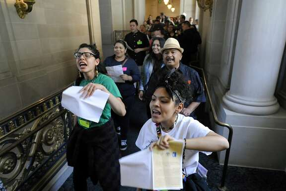Protestors and housing activists march through the hallways of City Hall during a board of supervisors meeting where supervisor David Campos introduced a bill putting a temporary moratorium on the construction of market-rate residential developments, in San Francisco, CA Tuesday, June 2, 2015.