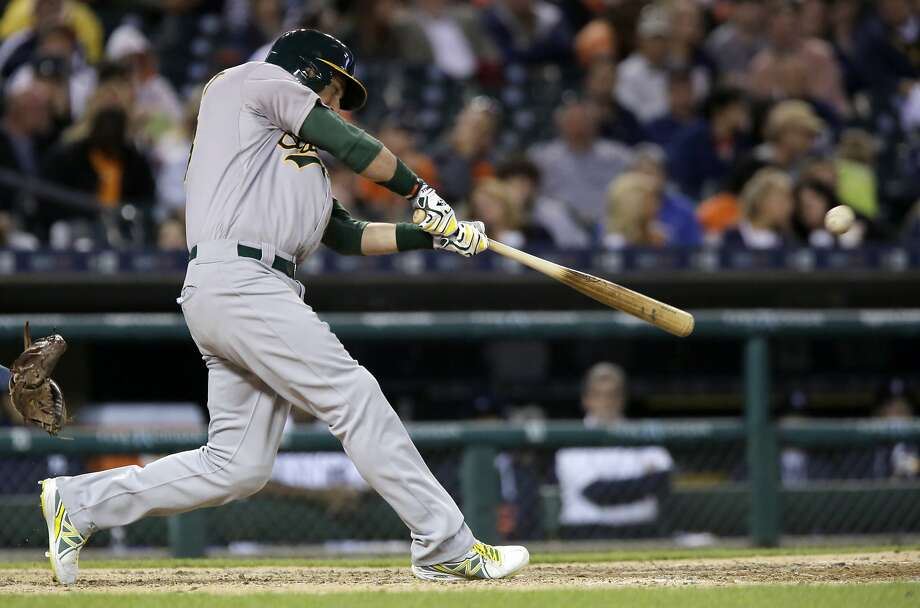 DETROIT, MI - JUNE 2:  Ben Zobrist #18 of the Oakland Athletics hits a grand slam against the Detroit Tigers during the seventh inning to take a 5-3 lead at Comerica Park on June 2, 2015 in Detroit, Michigan. (Photo by Duane Burleson/Getty Images) Photo: Duane Burleson, Getty Images