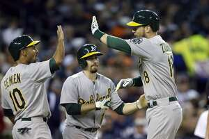 Tigers' miscue opens door, A's slam it - Photo