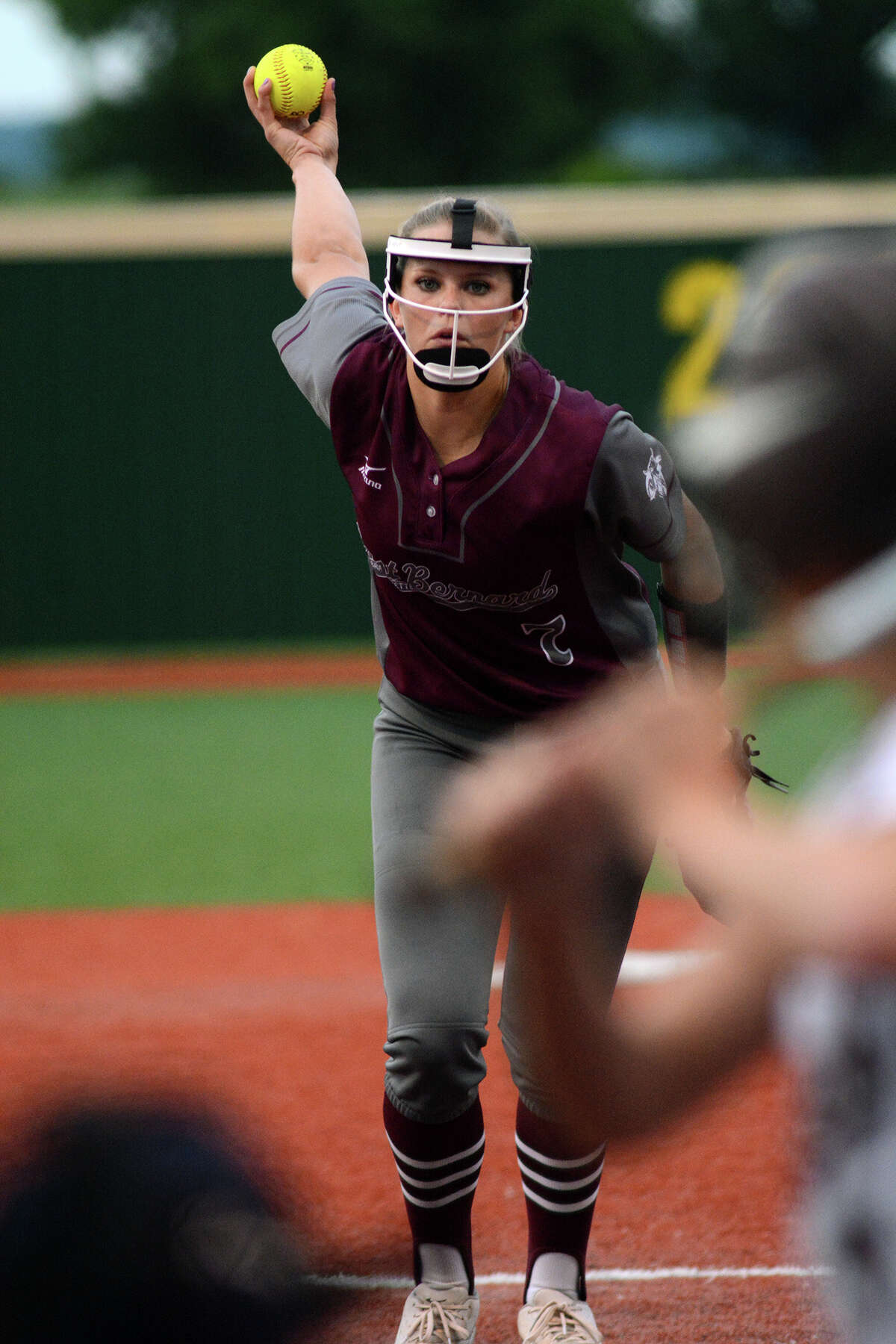 East Bernard senior pitcher Samantha Show works to a White Oak hitter during their Region III Class 3A final matchup at Mumford High School on Saturday, May 30,2015. (Photo by Jerry Baker/Freelance)
