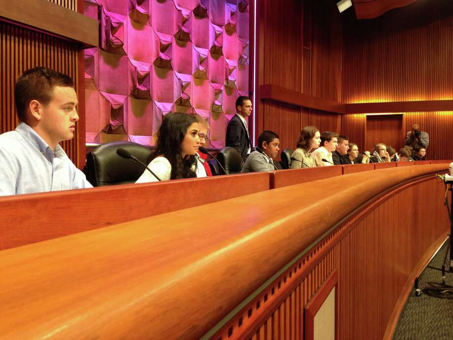 High school students listen to testimony on the state's teacher evaluation system as part of a student cabinet event organized by Assemblyman Angelo Santabarbara at the Legislative Office Building in Albany, N.Y., Tuesday, June 2, 2015.
