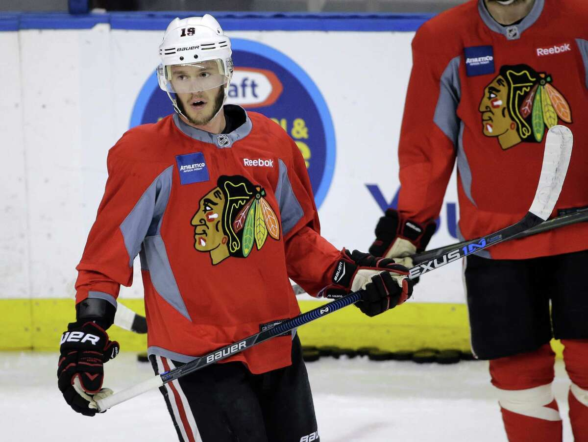 Chicago Blackhawks center Jonathan Toews watches drills during NHL hockey practice for the Stanley Cup Finals, Tuesday, June 2, 2015, in Tampa, Fla. The Blackhawks take on the Tampa Bay Lightning in Game 1 on Wednesday. (AP Photo/Chris O'Meara) ORG XMIT: TPA120