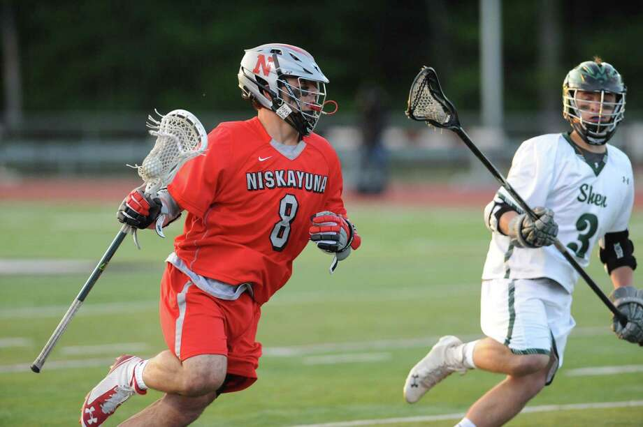 Niskayuna's Aidan Obrien looks for an opening during their high school lacrosse game against Shen on Tuesday May 12, 2015 in Clifton Park, N.Y. (Michael P. Farrell/Times Union) Photo: Michael P. Farrell / 00031788A