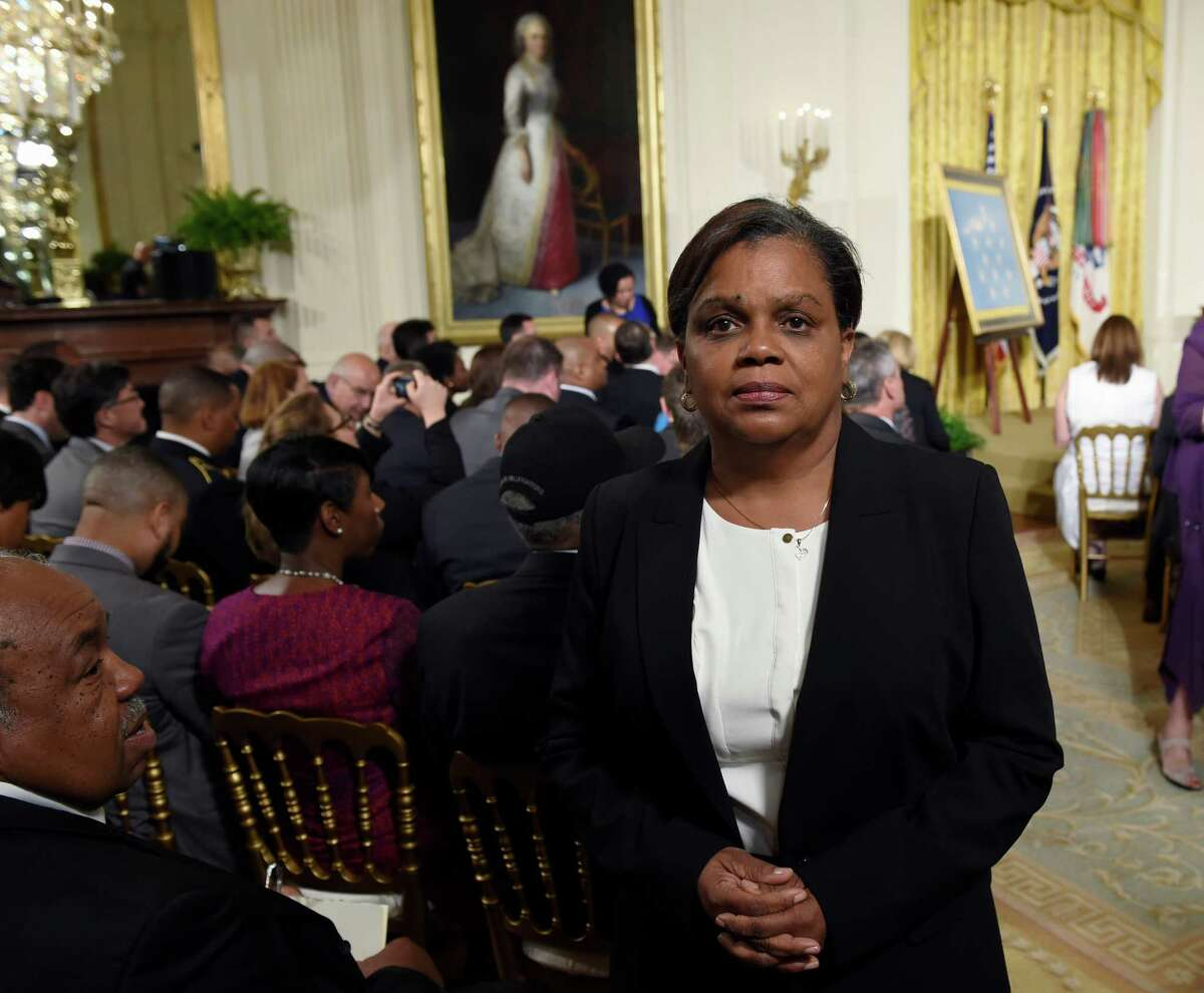In this photo taken June 2, 2015,Tara Johnson, poses for a photo in the East Room of the White House in Washington, Tuesday, June 2, 2015, before the Medal of Honor ceremony for the late Army Pvt. Henry Johnson. Two days before President Barack Obama announced a posthumous Medal of Honor for black World War I soldier Henry Johnson, a family got staggering news about the legacy of heroism that had inspired them for generations. A U.S. Army general visited Tara Johnson last month with word Johnson was not her grandfather, World War II Tuskegee airman Herman Johnson was not the hero?'s son. (AP Photo/Susan Walsh) ORG XMIT: WX101