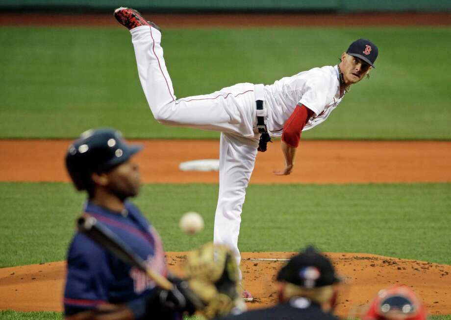 Minnesota Twins' Torii Hunter leans back from an inside pitch delivered by Boston Red Sox starter Clay Buchholz during the first inning of a baseball game at Fenway Park on Tuesday, June 2, 2015, in Boston. (AP Photo/Elise Amendola) ORG XMIT: MAEA104 Photo: Elise Amendola / AP
