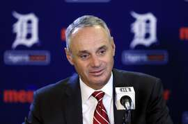 Baseball Commissioner Rob Manfred addresses the media before a baseball game between the Detroit Tigers and the Oakland Athletics, Tuesday, June 2, 2015, in Detroit. (AP Photo/Carlos Osorio)