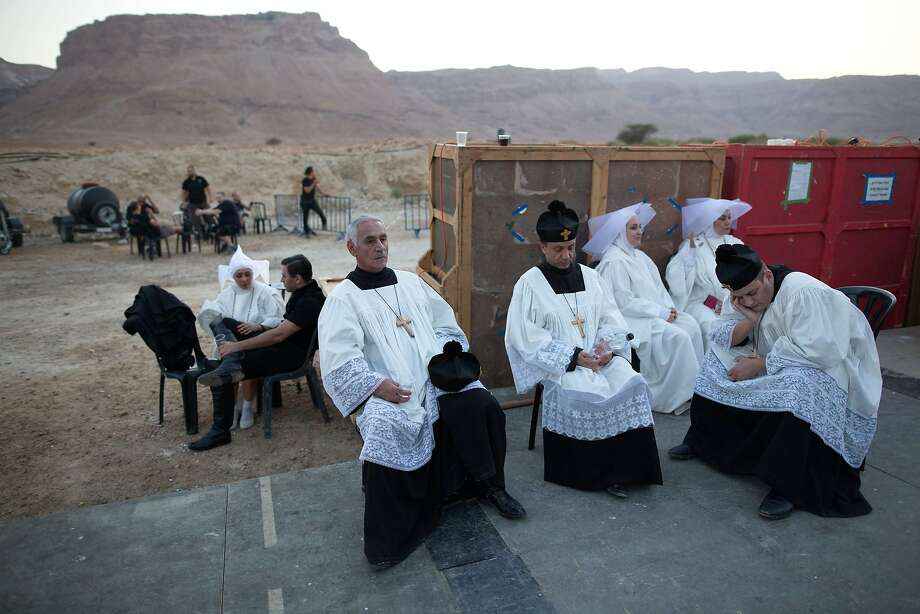 Opera singers and actors wait backstage during a full dress rehearsal of Tosca by Giacomo Puccini on a special stage set up against the backdrop of the ancient hilltop fortress of Masada in the Judean desert in southern Israel, on June 1, 2015. Israeli maestro Daniel Oron will conduct The Israel Symphony Orchestra Rishon LeZion and chorus with lead roles being sung by international singers. Photo: Menahem Kahana, AFP / Getty Images
