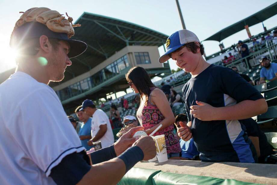 Hayes Johnson of Blanco, Texas gets an autograph from Missions shortstop Trea Turner before a game between the San Antonio Missions and the Arkansas Travelers. Ray Whitehouse Staff /San Antonio Express-News Photo: Ray Whitehouse, Staff / San Antonio Express-News / 2015 San Antonio Express-News