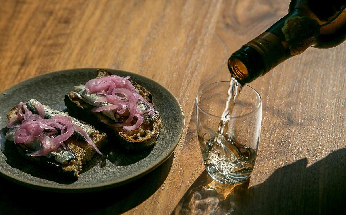 """""""La Guita"""" Manzanilla Sherry with the Sardine plate at Tofino in San Francisco, Calif., is seen on June 2nd, 2015."""