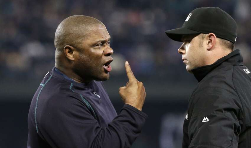 Seattle Mariners manager Lloyd McClendon, left, yells at umpire Will Little after being ejected in the third inning of a baseball game Tuesday, June 2, 2015, in Seattle. (AP Photo/Elaine Thompson)