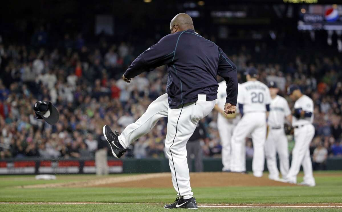 Seattle Mariners manager Lloyd McClendon kicks his baseball cap along the first base line after being ejected from the baseball game the third inning against the New York Yankees on Tuesday, June 2, 2015, in Seattle. (AP Photo/Elaine Thompson)