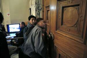 Oakland protesters oppose tower, but this time meeting goes on - Photo